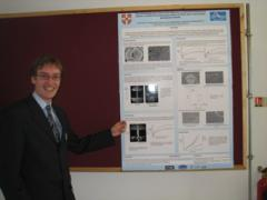Tim presenting his poster at the Bradford muPP2 meeting