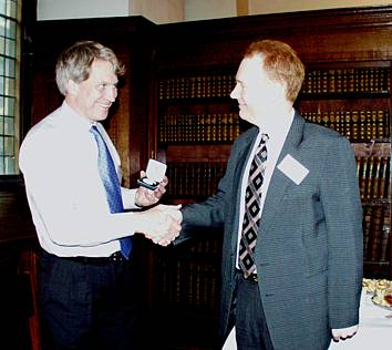 Photo of Dr  Middelberg presenting the medal to Dr Buckland