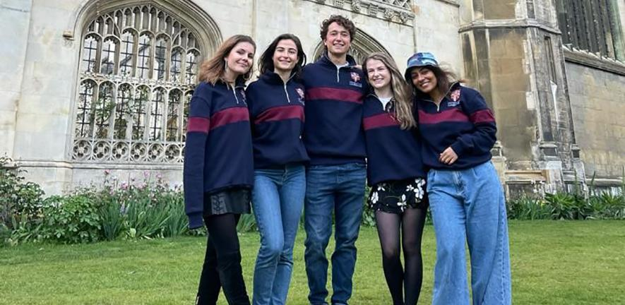 The five members of the CardiaTec team standing in front of King's College Cambridge