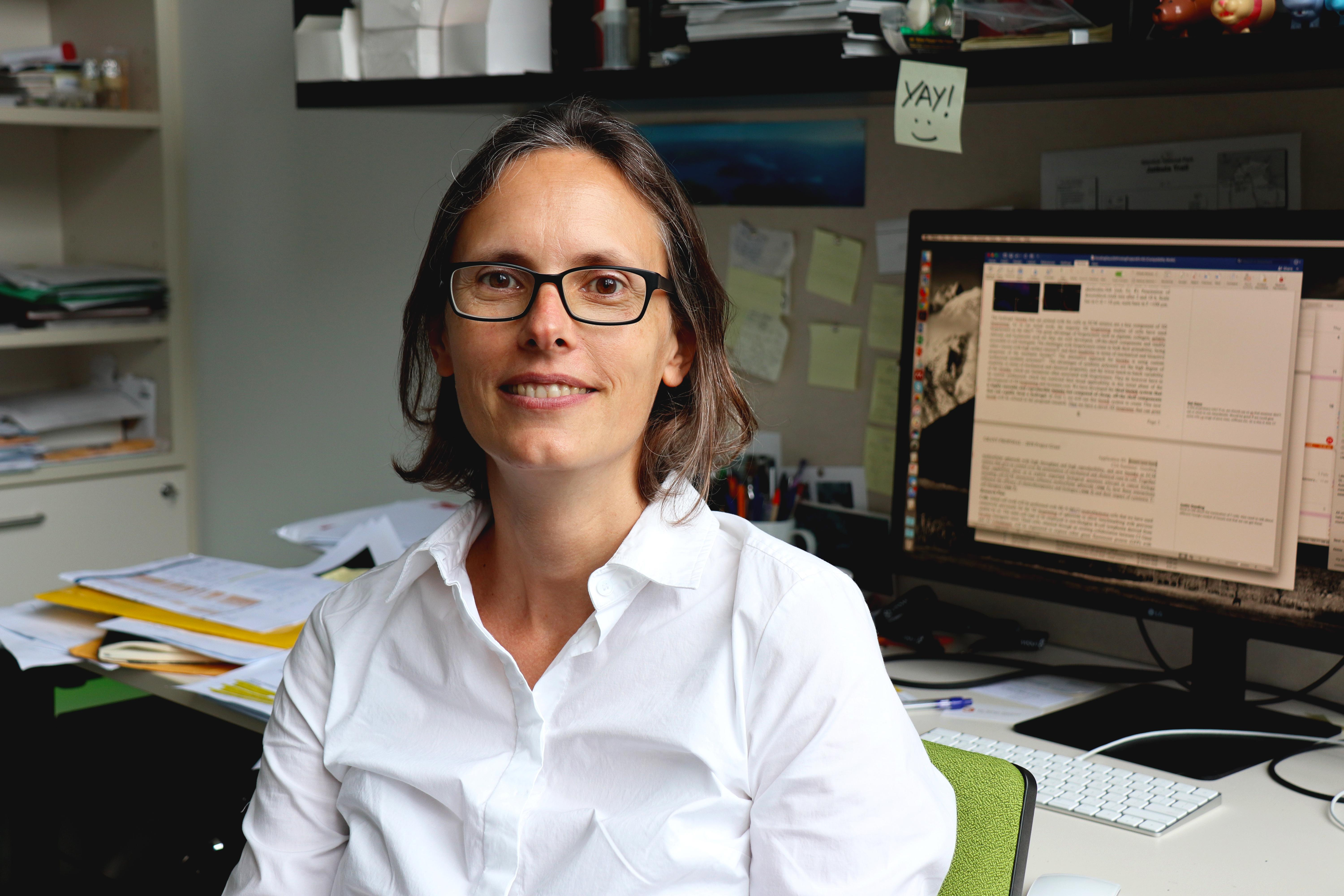 Deceased Alumna Professor Katharina Gaus in her office (Credit@University of New South Wales, Sydney)