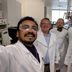 Hirak in the lab with colleagues from the Bioscience Engineering Group